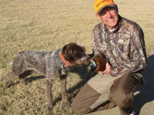 Cliff and Belle (9 month old female Wirehaired Pointing Griffon) with her first pheasant
