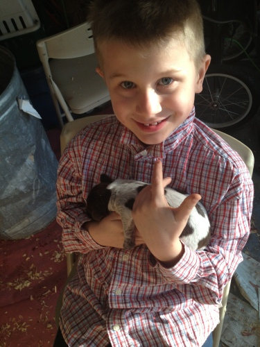 Conrad (almost 9 years old) holds a pup