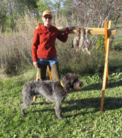 Susan and TracHer with a limit of sharp-tailed grouse.