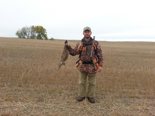 Charles and the first pheasant of the trip.  Photo courtesy of Oscar Hollenbeck
