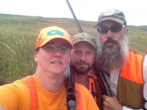 Charity, Charles, and Ryan take a selfie in the grouse field.