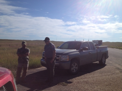 Charles talks to Conservation Officer Frank Miller