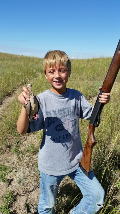 My friends Ashley and Matt's son Gavin and his first dove harvest in the Sandhills.