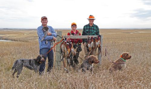 TracHer, Tom holding Max the GWP pup, Susan, Max the griff, Jim, and Zepher.